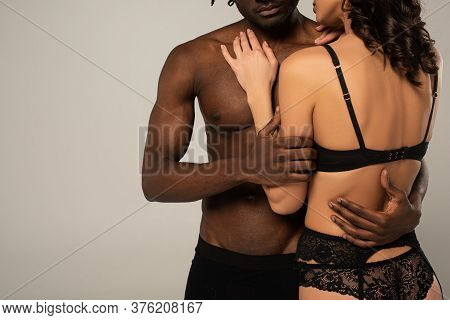 View Of Multicultural Intimate Couple Hugging Isolated On Grey