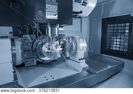 The 5 Axis Cnc Machining Center Cutting The Mechanical Parts With Solid Ball End-mill Tools. The Hi-