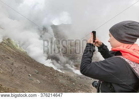 Girl Tourist Takes Pictures Of Stunning Volcanic Landscape, Aggressive Hot Spring, Eruption Fumarole