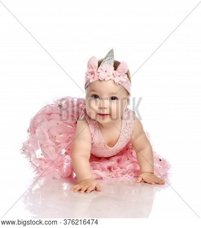 Curious Adorable Little Infant Baby Girl Toddler In Pink Dress And Crown On Head, The Costume Of The