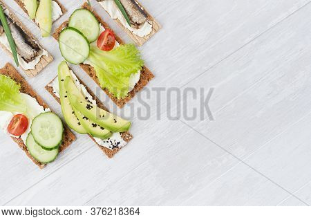 Fresh Spring Vitamine Sandwiches Of Flat Cereal Rye Dry Crisps Bread With Fresh Slices Vegetables, F