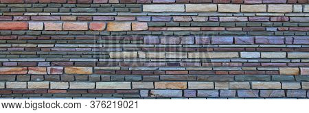 Surface And Texture Of Multy-colored (colorful) Decorative Stone Wall, Background. Varicolored Flat