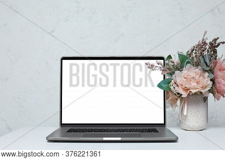 Laptop With Blank Empty Screen On White Table. Home Interior. Mockup