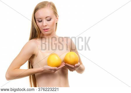 Woman Small Boobs Holds Big Orange Fruits