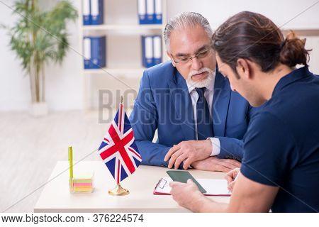 Young man visiting embassy for visa application