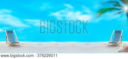 Deck Chairs On Summer Beach Background. Social Distancing For Seat At Least 2 Metres Or 6 Feet Away