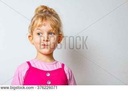 Portrait Of Funny And Merry Sweet Little Girl Until She Make Funny Face Expression.