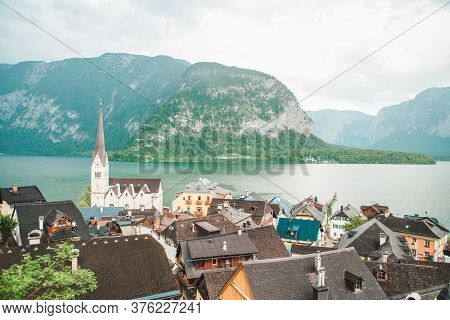 Hallstatt Church With Bell Tower Lake With Alpine Mountains On Background