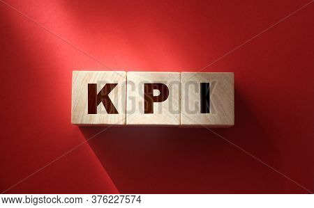 Kpi On Wooden Blocks, Key Performance Indicator Kpi Concept, Top View On Red