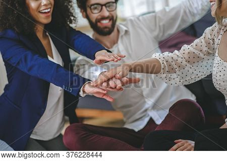 Three Friends Fellow Enthusiasts Showing Their Unity Gesturing