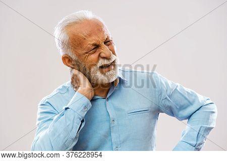 Portrait Of Senior Man Who Is Having Pain In Neck.