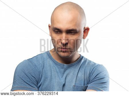Photo Of Young Bald Puzzled Man In Tee Shirt