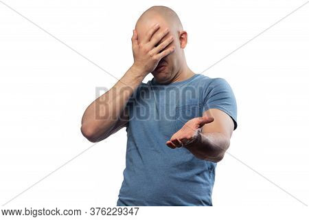 Photo Of Bald Puzzled Man In Tee Shirt Showing Facepalm Gesture