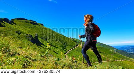 hiking trail,  woman with backpack- Plomb du Cantal, Auvergne-Cantal