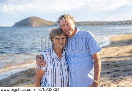 Senior Couple In Love By The Sea. Retired Old Woman And Man Enjoying Retirement Lifestyle Feeling Ha