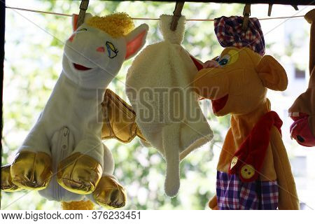 Children's Toys Are Dried On Clothespins. Soft Toys Hang On A Clothesline, Toys Are Fixed With Cloth
