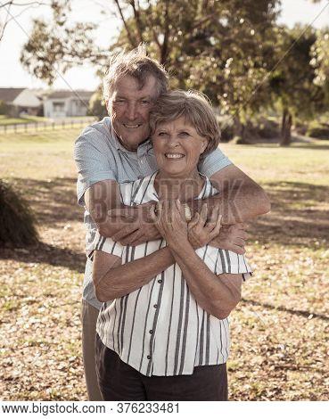 Portrait Of Elderly Senior Couple Enjoying Retirement Lifestyle Feeling Happy Aging Together