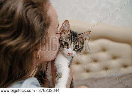 Young Woman Kisses A Cat.girl With Cat.