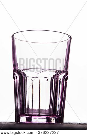 Empty Transparent Faceted Glass Cup Isolated On White. Close Up Clean Glassware Vintage Cup.