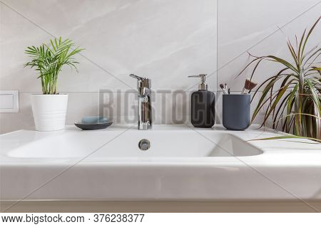 Bathroom Interior With Sink, Washbasin, Soap And Green Tropical Plants. Modern Bathroom Design