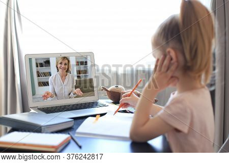 Distance Learning. Cheerful Little Girl Using Laptop Computer Studying Through Online E-learning Sys