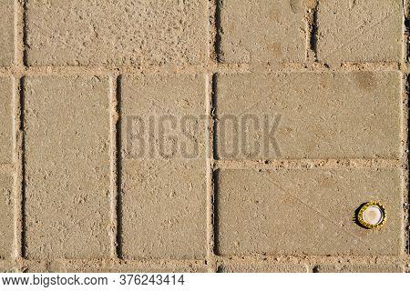 Close-up Sidewalk Made Of Cobblestones. Pattern Of Grey Rectangular Blocks.