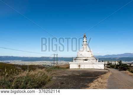 View Of Abandoned Old White Mysterius Buddhist Temple Dome Near Old Sensuikyo Ropeway To Mount Aso W