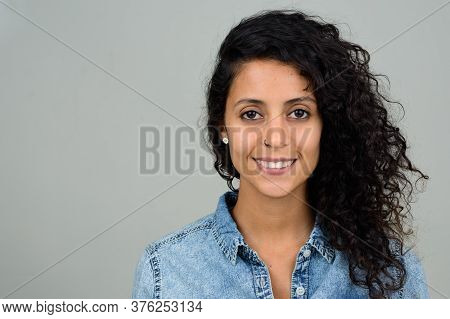 Portrait Of Happy Young Beautiful Hispanic Woman