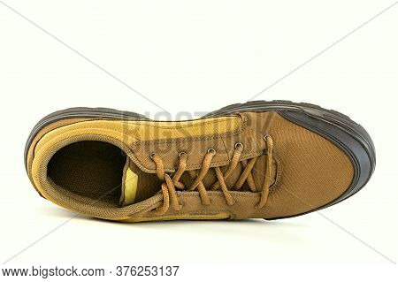 One Right Cheap Yellow Fabric Hiking Shoe Isolated On White Background