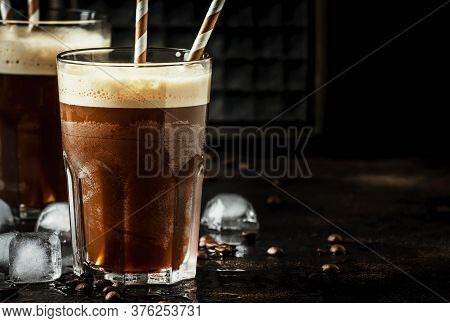 Cold Frappe Coffee With Ice And Foam In Large Glasses On Brown Background, Selective Focus