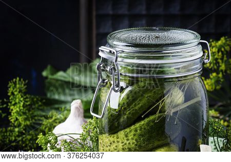 Homemade Marinated Cucumbers With Dill And Spices In A Glass Jar On A Brown Background, Selective Fo