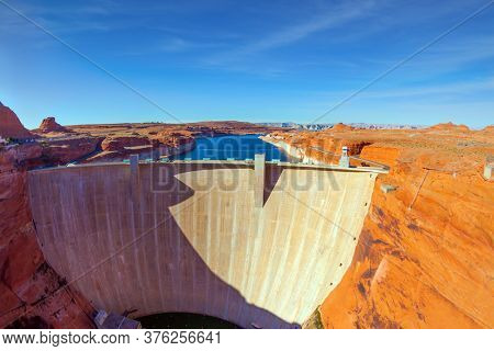 Best journey in life. Glen Canyon Dam across the Colorado River to scenic red sandstone. Glen Canyon Dam - located in Arizona, in the Grand Canyon Gorge. Concept of photo tourism