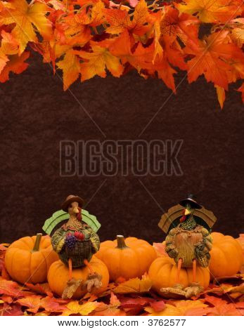 Pumpkins sitting together on leaves with a turkey sitting on one pumpkin border poster