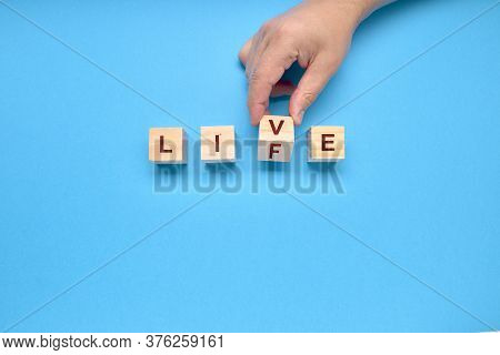 Person Moves One Die With The Words Live And Life With Copy Space. Lifestyle Concept