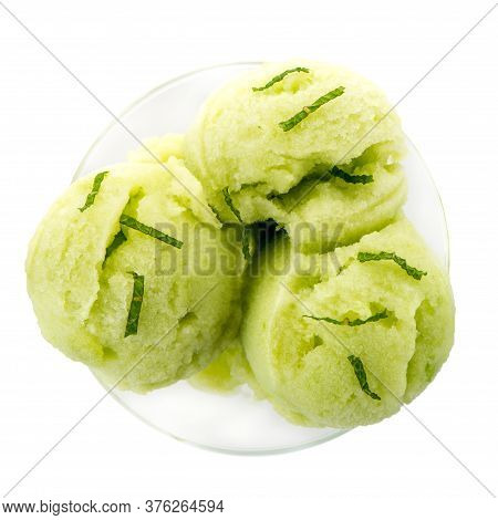 Close Up Of Melon Flavored Ice-cream Isolated On White Background.