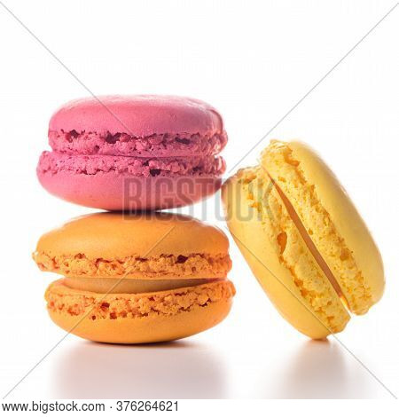 Three Delicious Colorful Macaroons On White Background.