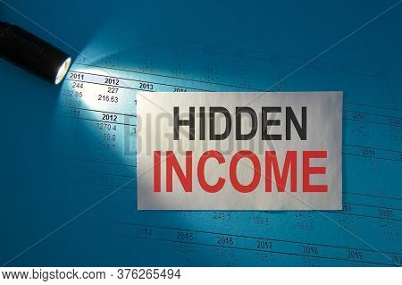 Hidden Income - Inscription On A White Card In The Beam Of Light