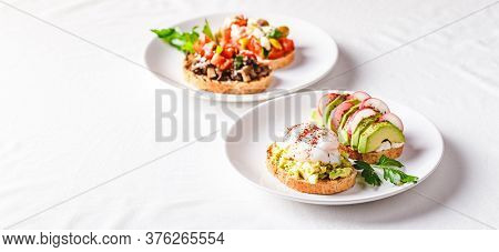Toast With Avocado And Poached Egg And Toast With Avocado And Radish. Healthy Food Concept. Place Fo