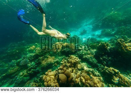 Girl Snorkeling In White Bikini Swimming Deep In Coral Reef Of Surin Islands, Andaman Sea, North Of
