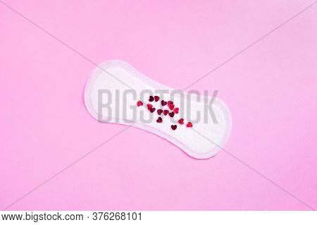 Menstrual Daily Sanitary Pad With Red Hearts That Mimic Blood On Pink Background. Minimal Concept Ca