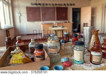 Table With Old Chemical Reagents In A Classroom In An Abandoned School, An Abandoned Chemistry Offic