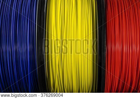 Romania Flag Of The Coils For 3d Printer. Filament For 3d Printing. Bright Thermoplastic Of Blue, Ye