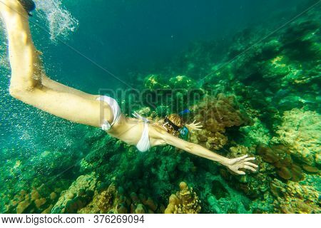 Side View Of Snorkeling Girl In Apnea Swimming In Surin Islands, Andaman Sea, North Of Phuket, Phang