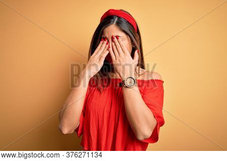 Young beautiful woman colorful summer style over yellow isolated background rubbing eyes for fatigue and headache, sleepy and tired expression. Vision problem