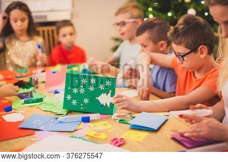 Kids Engaged Into Creating Handmade Christmas Cards