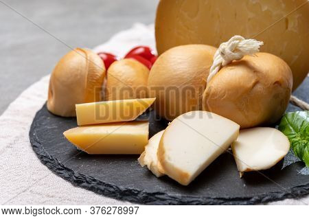 Italian Semi Hard Handmade Smoked Scamorza And Caciocavallo Matured In Caves Cheeses Made From Cow M