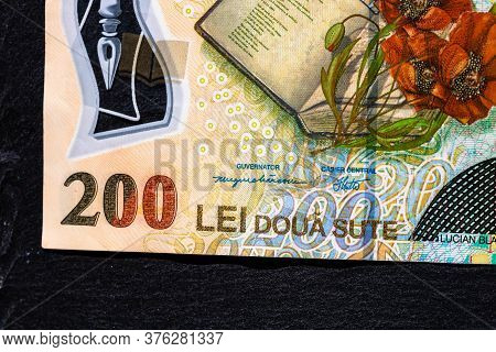 Selective Focus On Detail Of Lei Banknotes. Close Up Macro Detail Of Romanian Lei Banknotes, 200 Lei