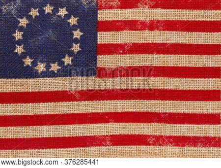 Old Vintage Betsy Ross American Flag With Stars In A Circle On Burlap Background