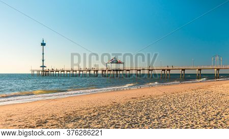 Iconic Brighton Jetty With People At Sunset, South Australia