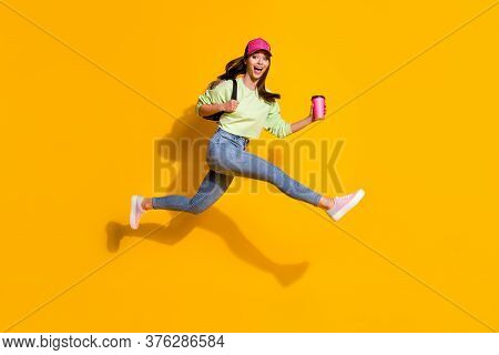 Full Body Profile Photo Of Energetic Lady Student Hold Backpack Takeout Coffee Jump High Rushing Les